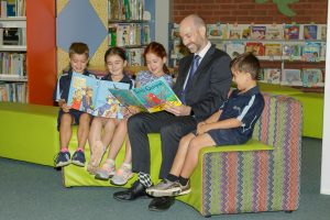 Principal Paul Fuller reading with students